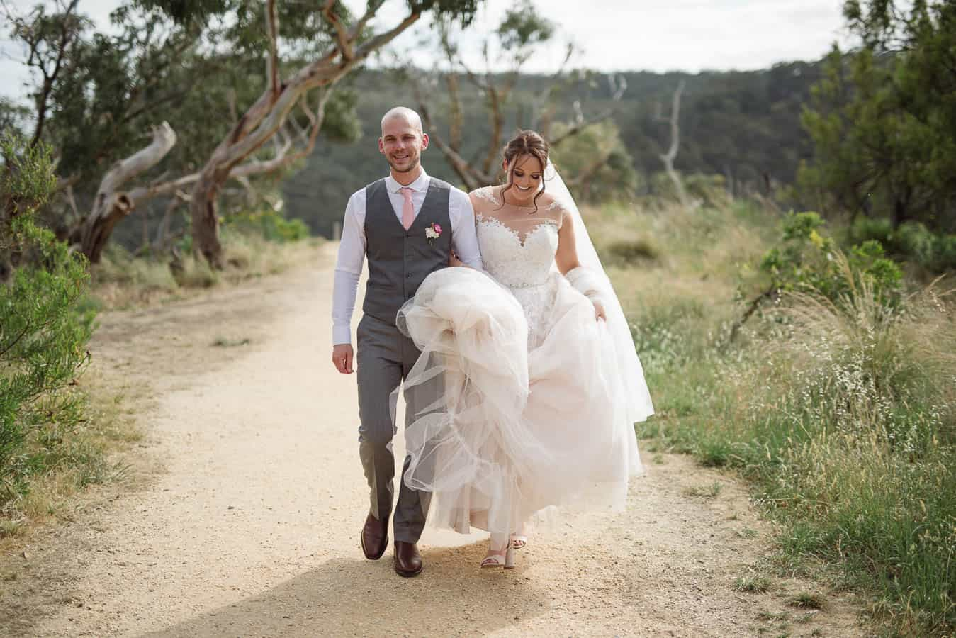 Bride and Groom walking at Teddy's lookout in Lorne