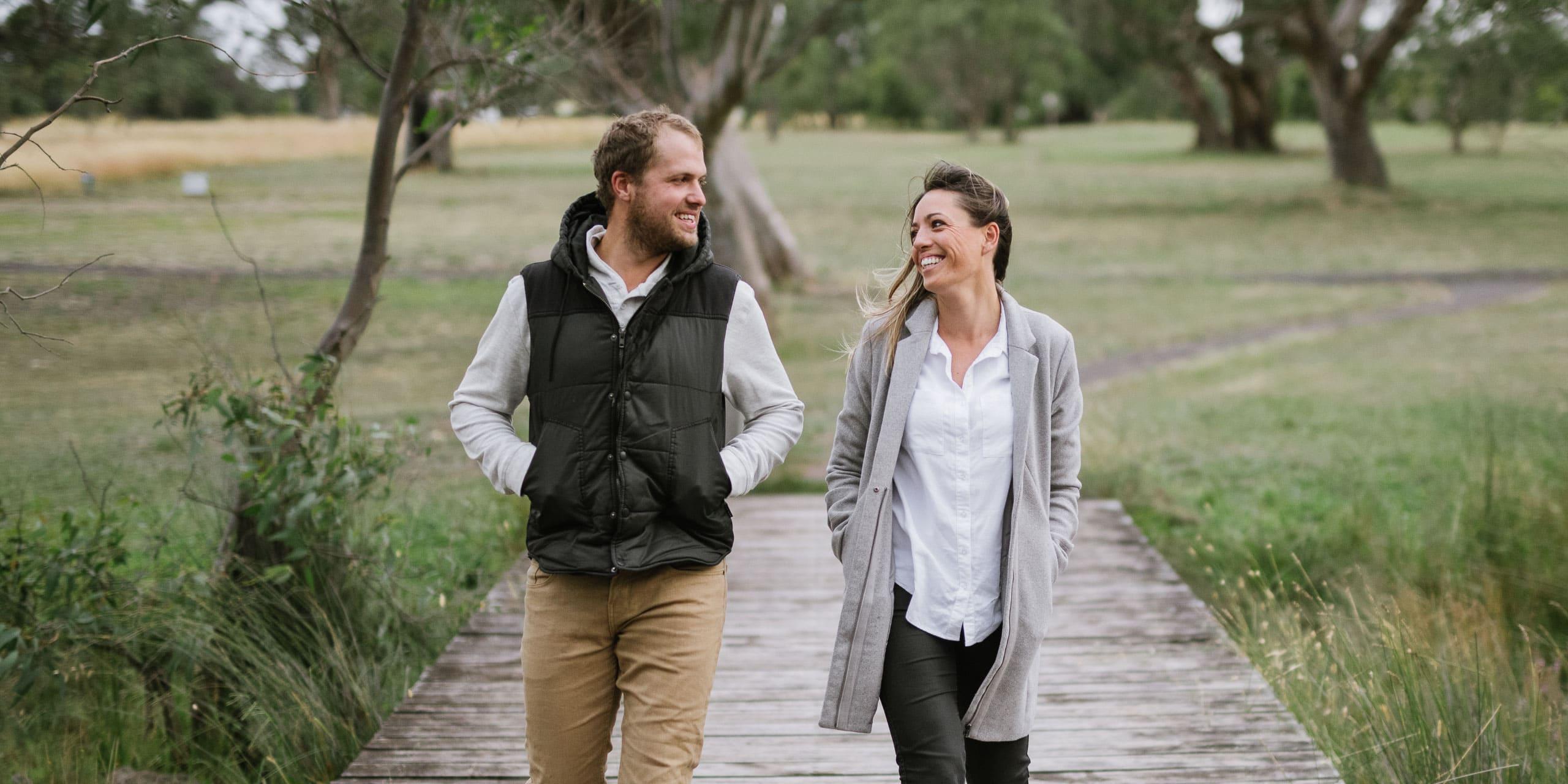 Portrait of couple in love walking towards camera