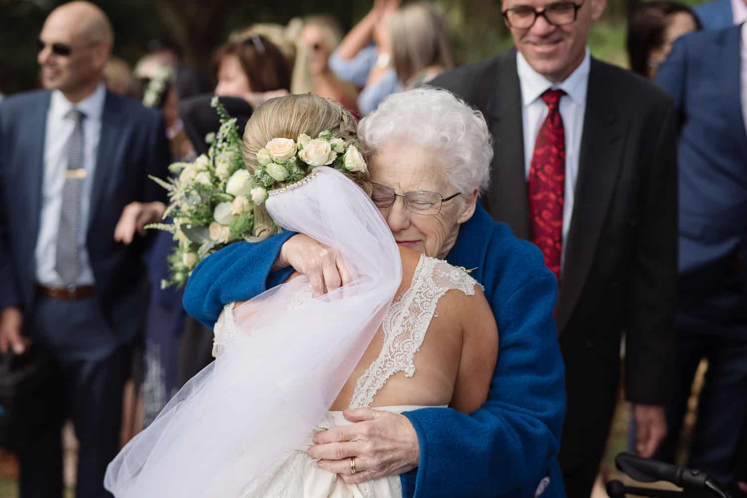 Bride hugging her emotional grandmother