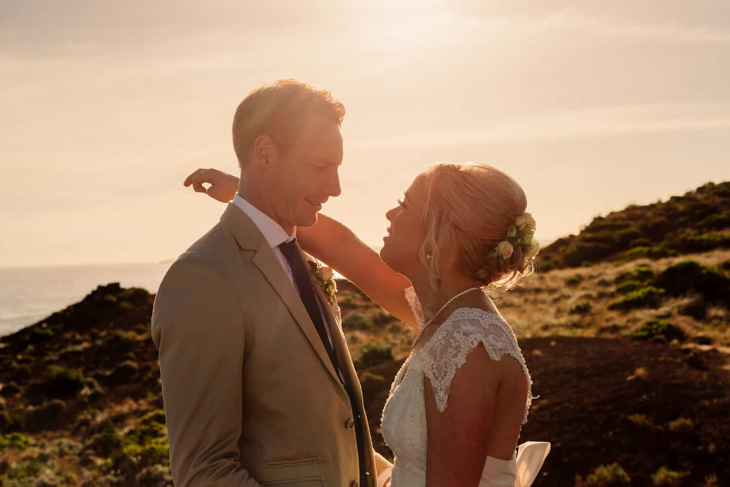 Golden light portrait of a bride and groom on the great ocean road