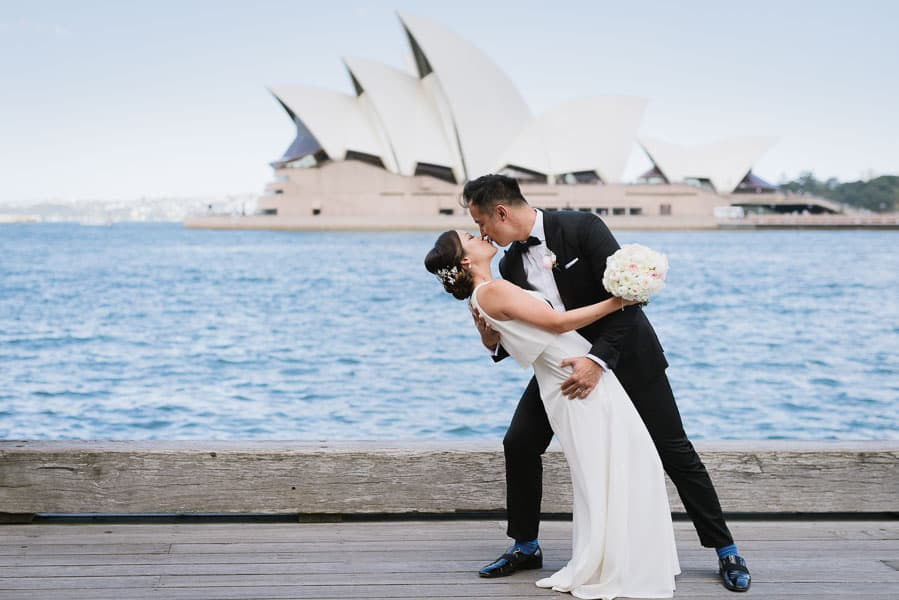Bride and Groom kissing with the Sydney Opera House