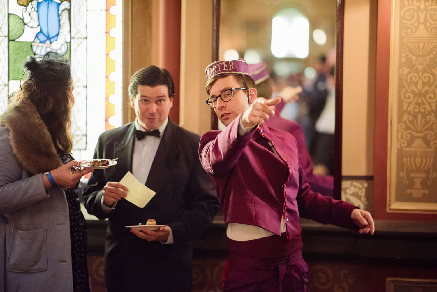 Porter directs guests at UGC Hotel