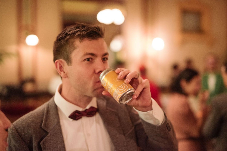 Man drinks quiet deeds beer