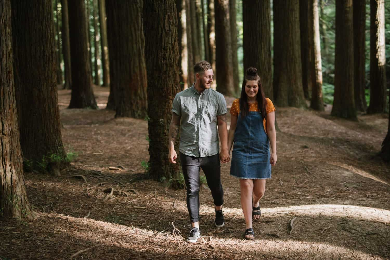 Chelsea and Luke walk through the redwood forest