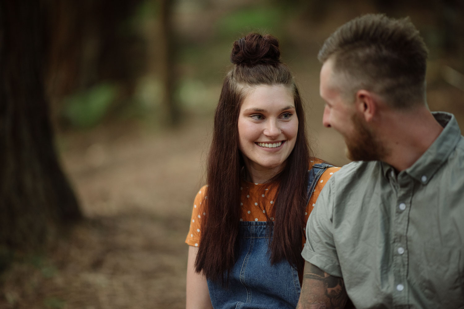 Chelsea smiles at Luke on their engagement session
