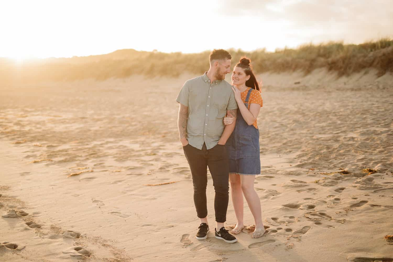 Couple in golden sunset light at Apollo Bay beach