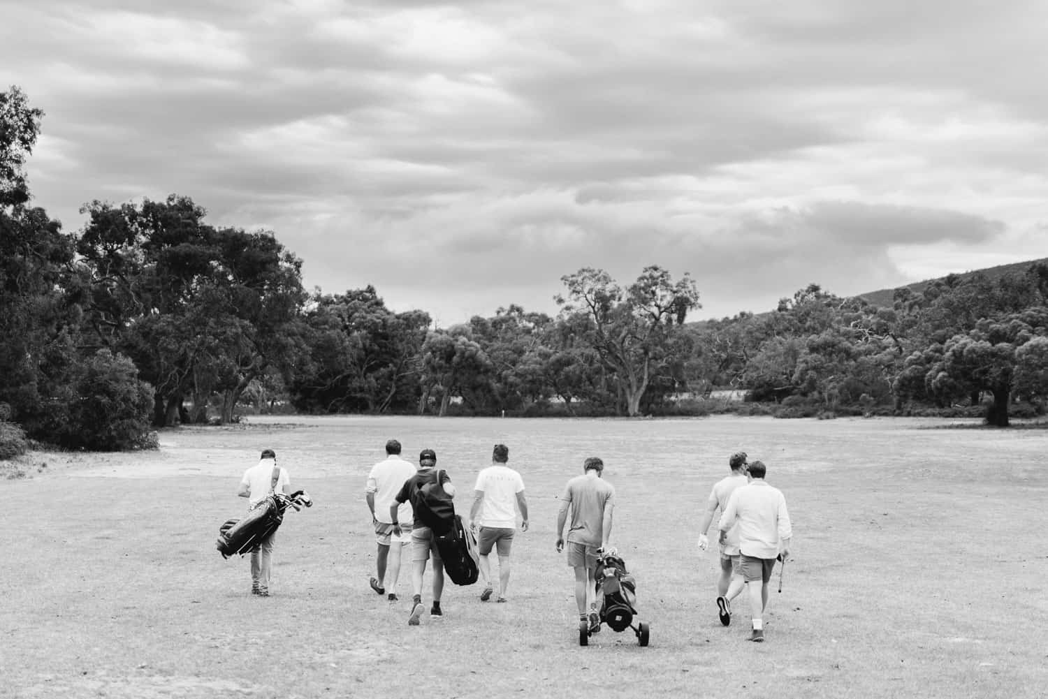 Groomsmen playing golf at Dunkeld golf club