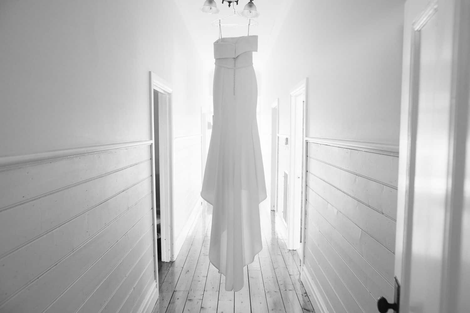 Wedding dress hung in Hamilton hallway