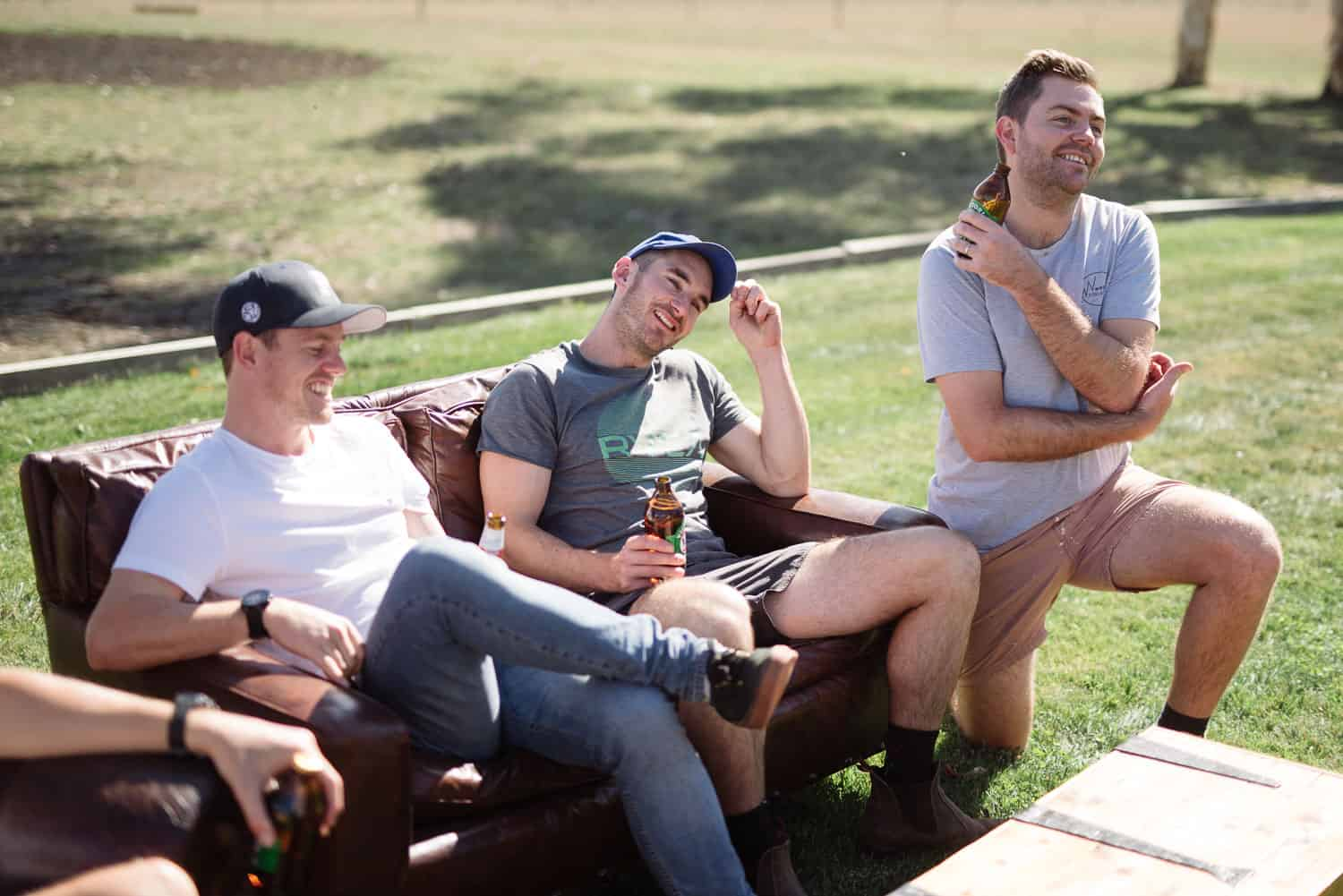 Groomsmen relaxing before a hamilton backyard wedding