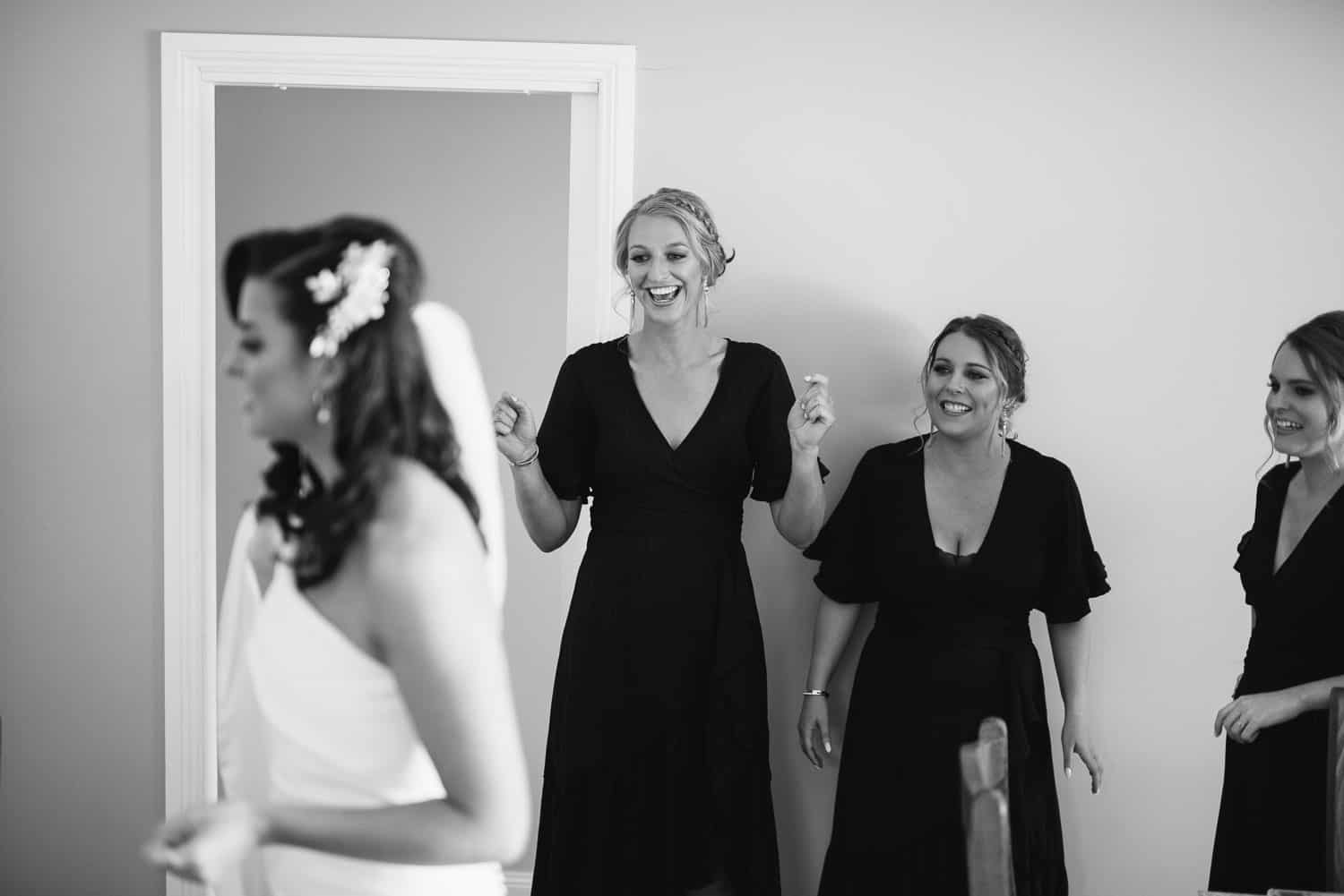 Bridal party excited by dress
