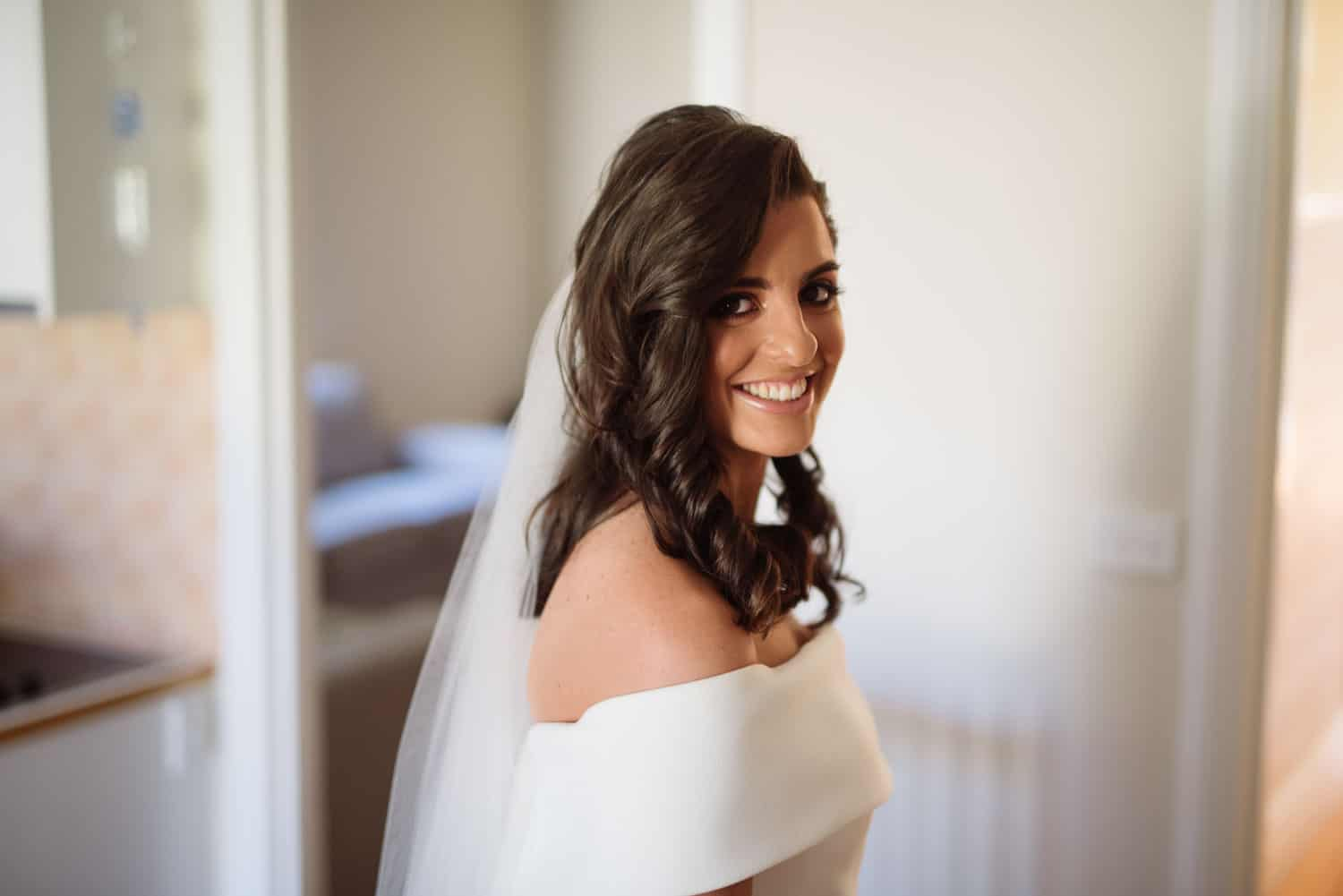 Bride smiling in her dress