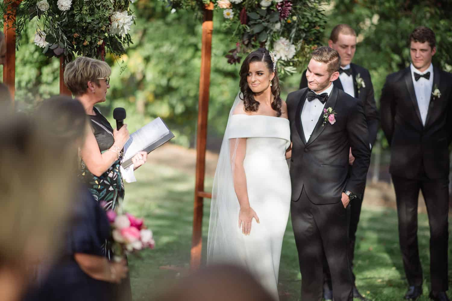 Relaxed speeches at a garden wedding