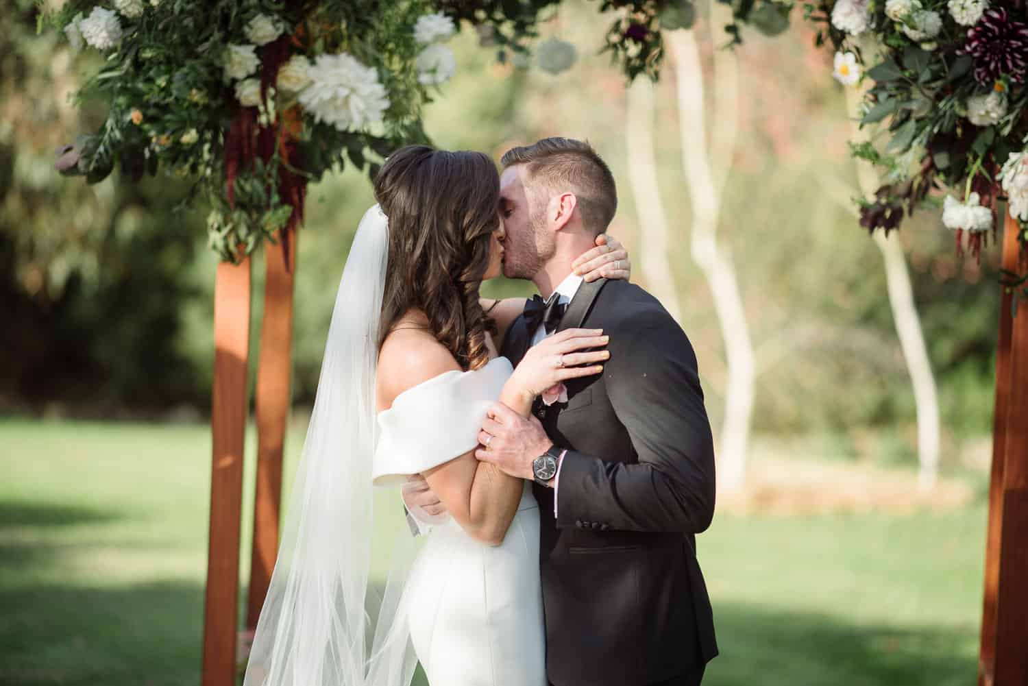 First kiss at a hamilton backyard wedding