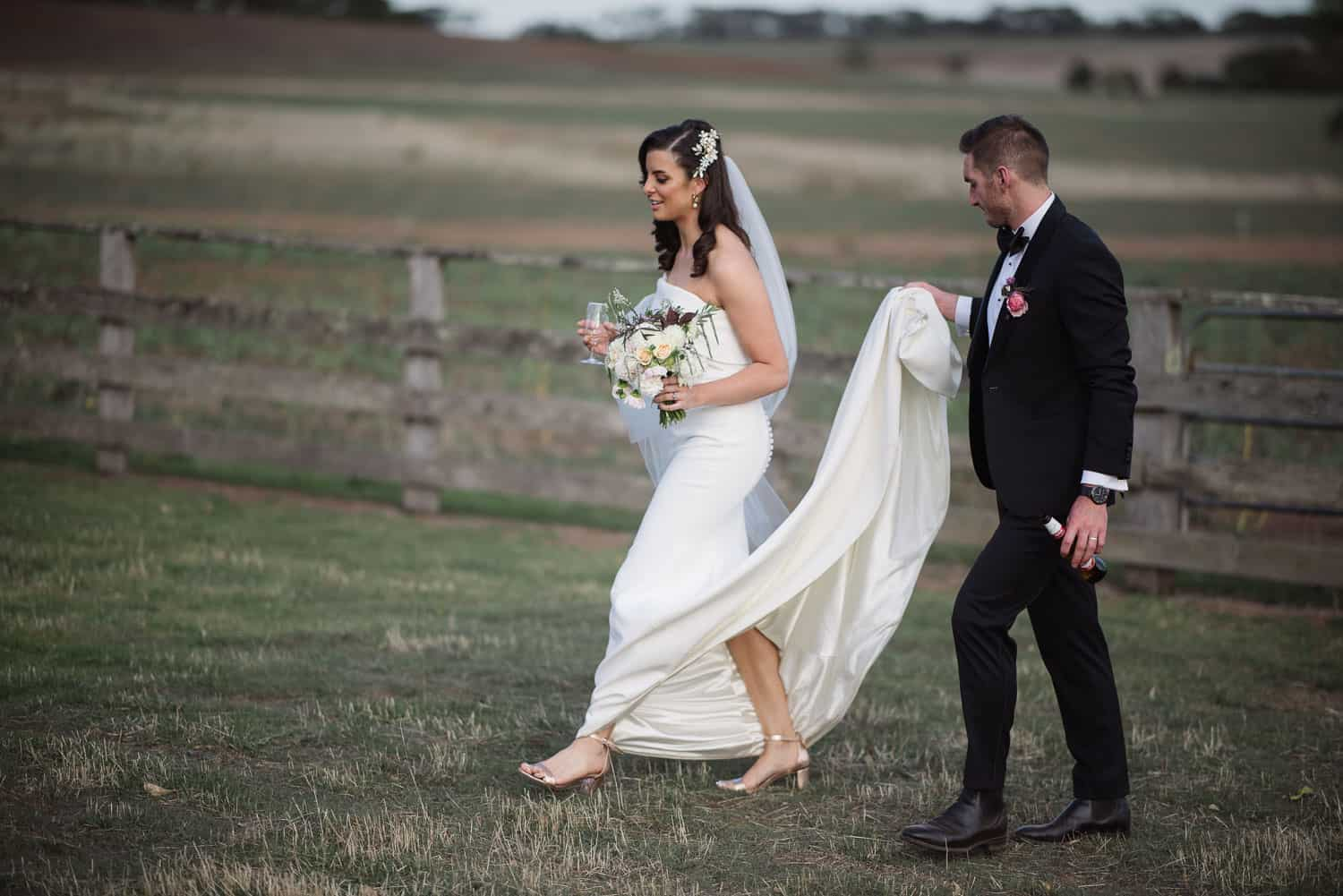 Couple walking after wedding in country victoria