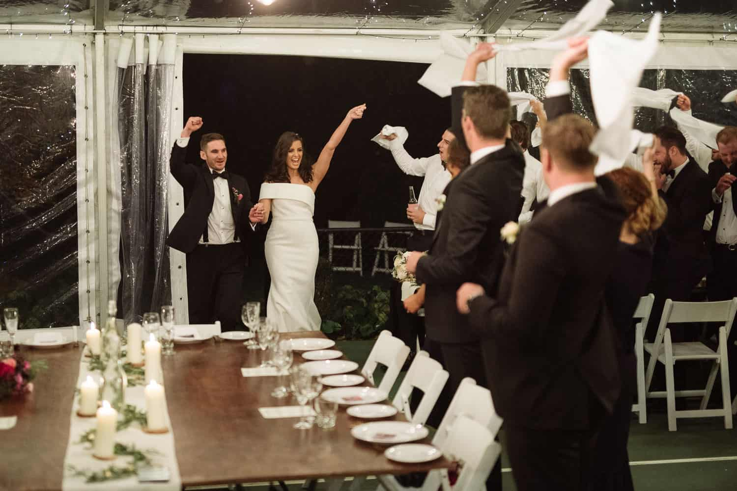 Bride and groom enter their backyard reception