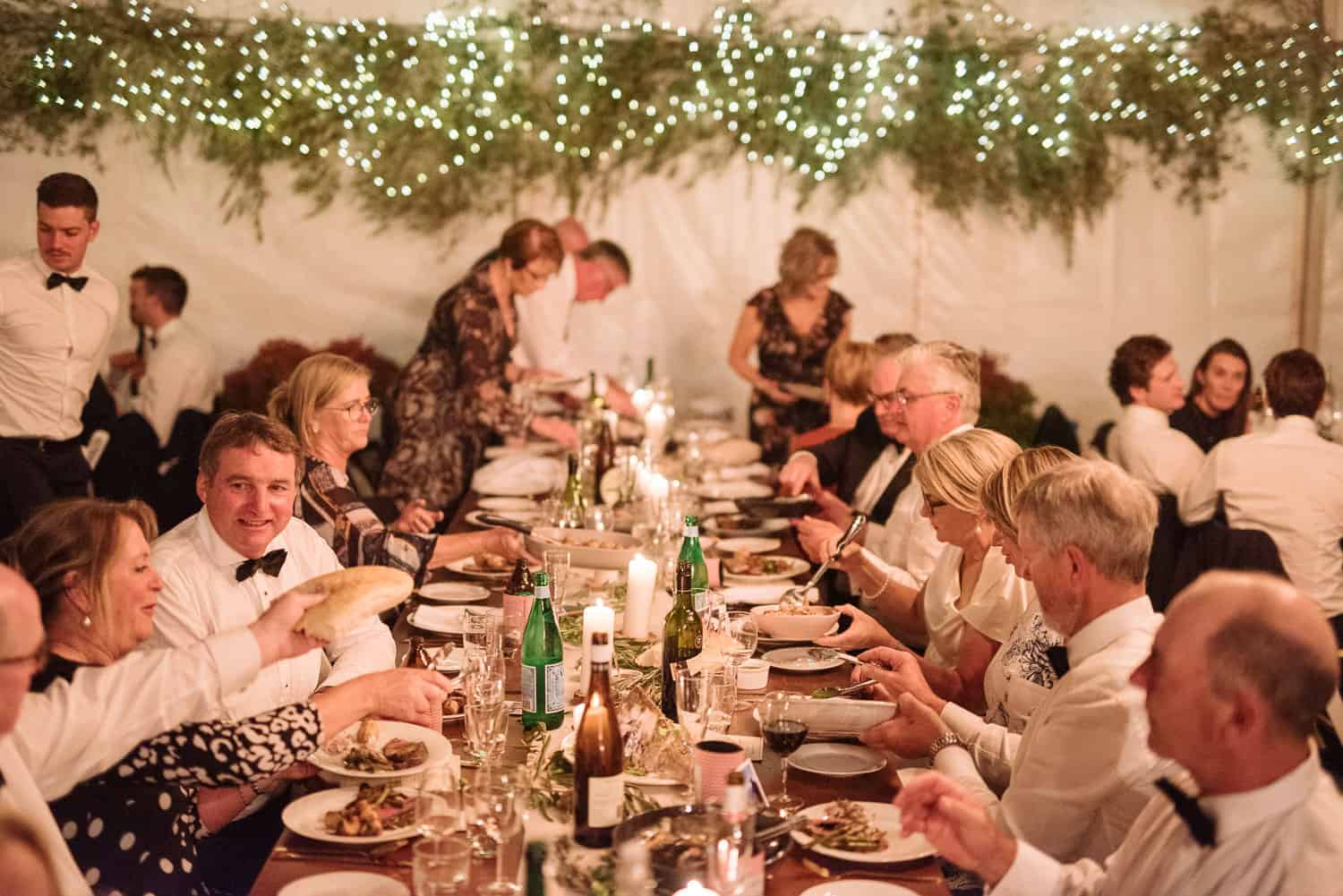 Wedding guests enjoy a delicious meal