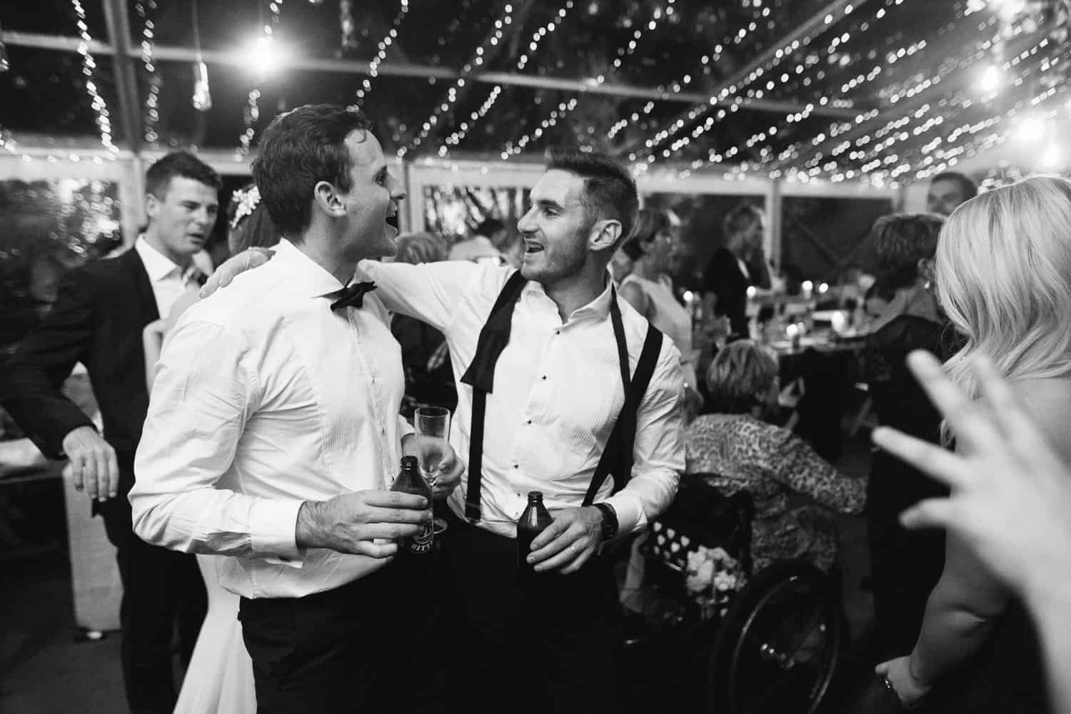 Groom celebrating on the dancefloor
