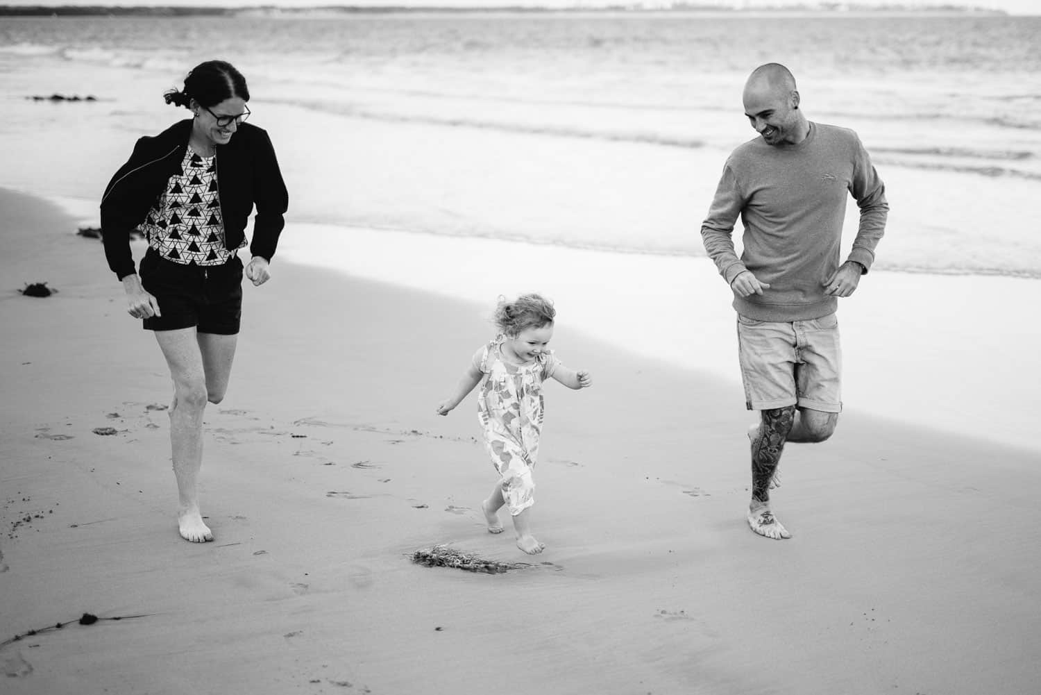 Family running on the beach at Point Lonsdale