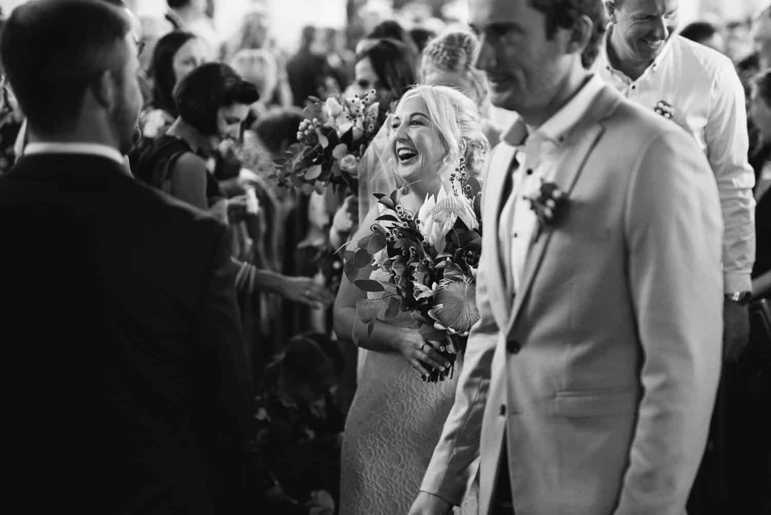Bride laughs during recessional