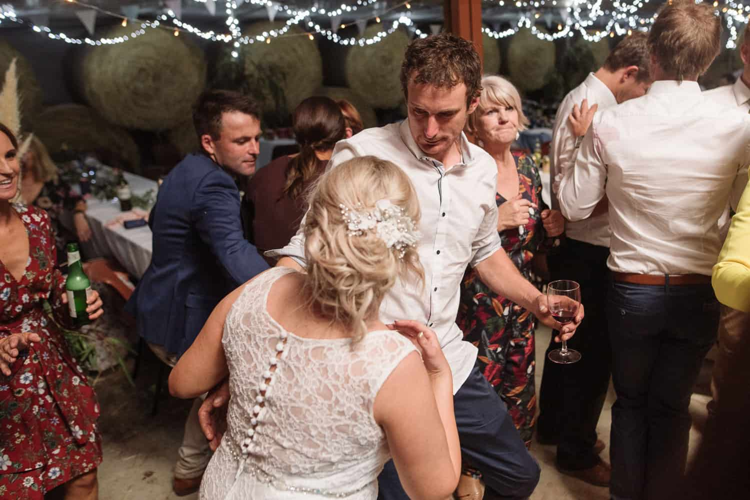 Groom dancing with his bride in a shed