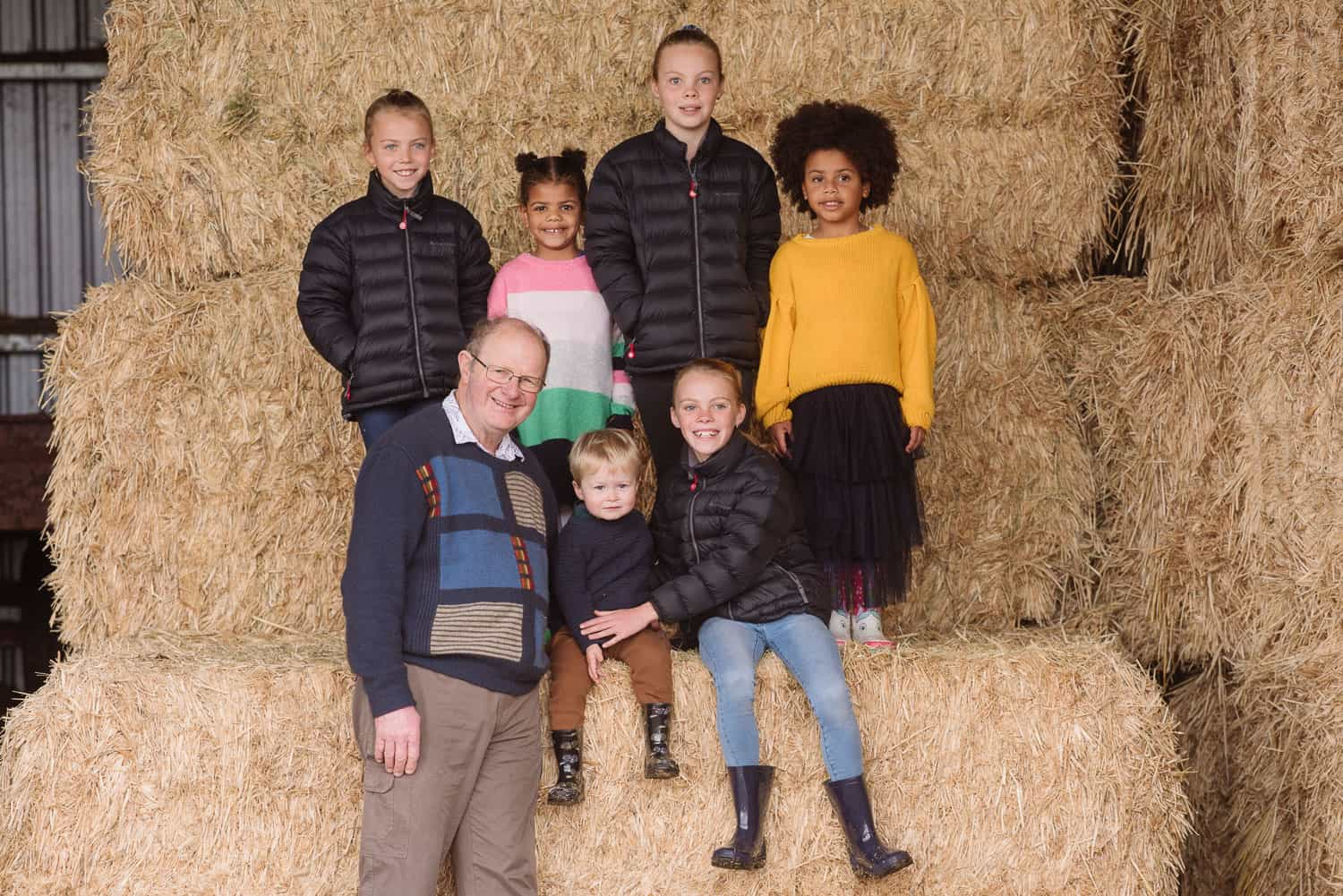 Family portrait in a hayshed