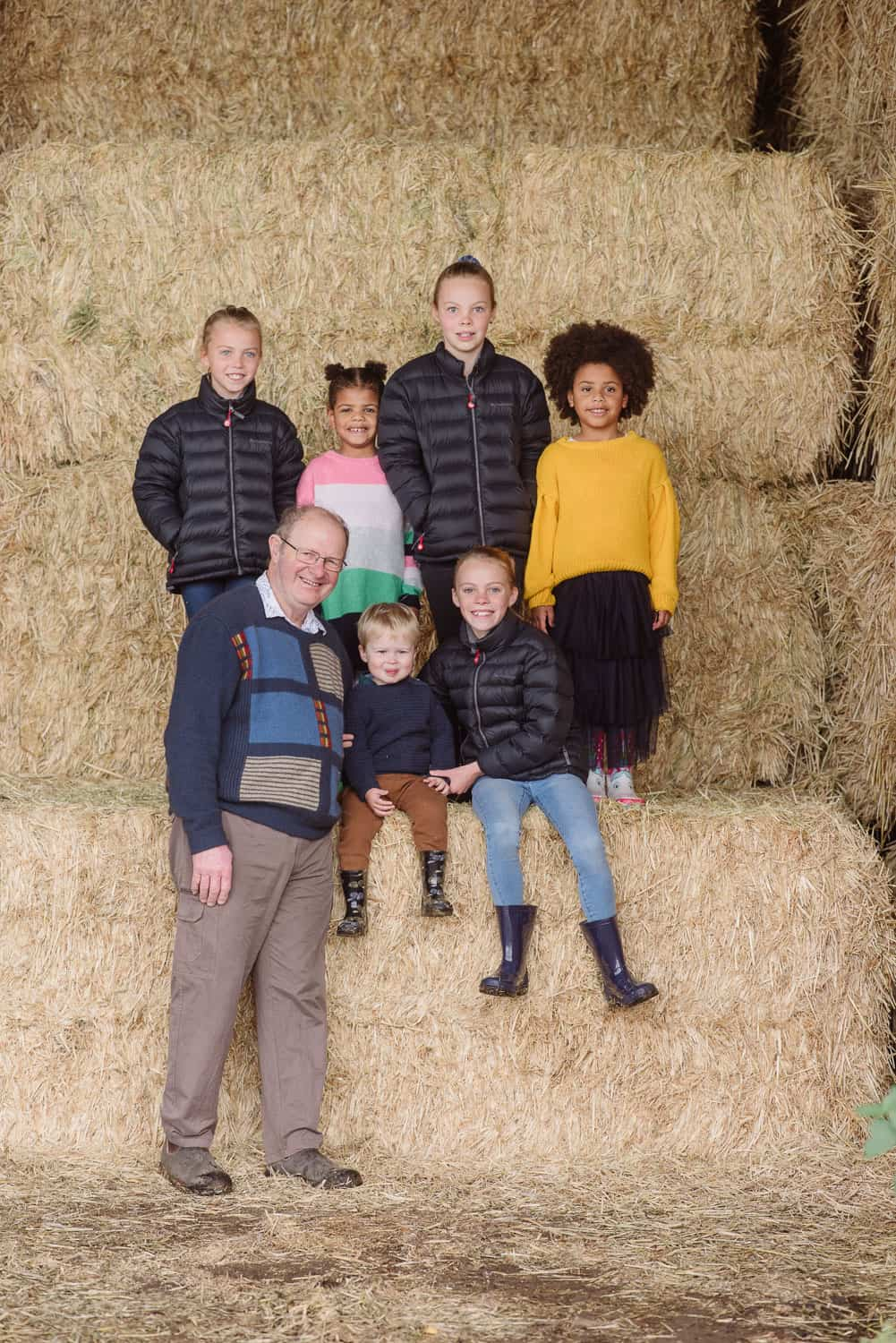 Grandchildren in a hayshed