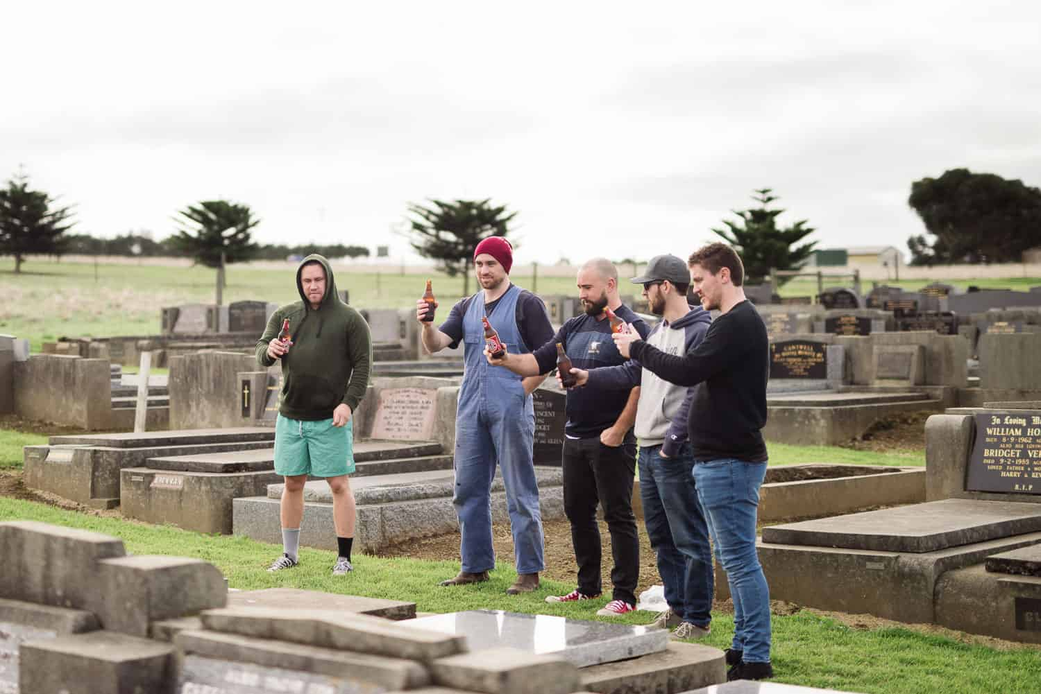 Groomsmen visit a relative's grave