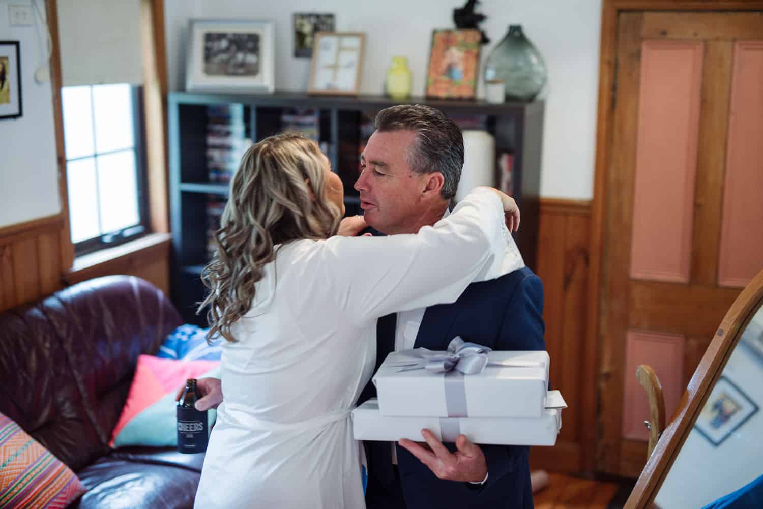 Bride kisses her father before her wedding