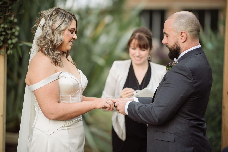 Exchanging wedding rings at a Warrnambool wedding