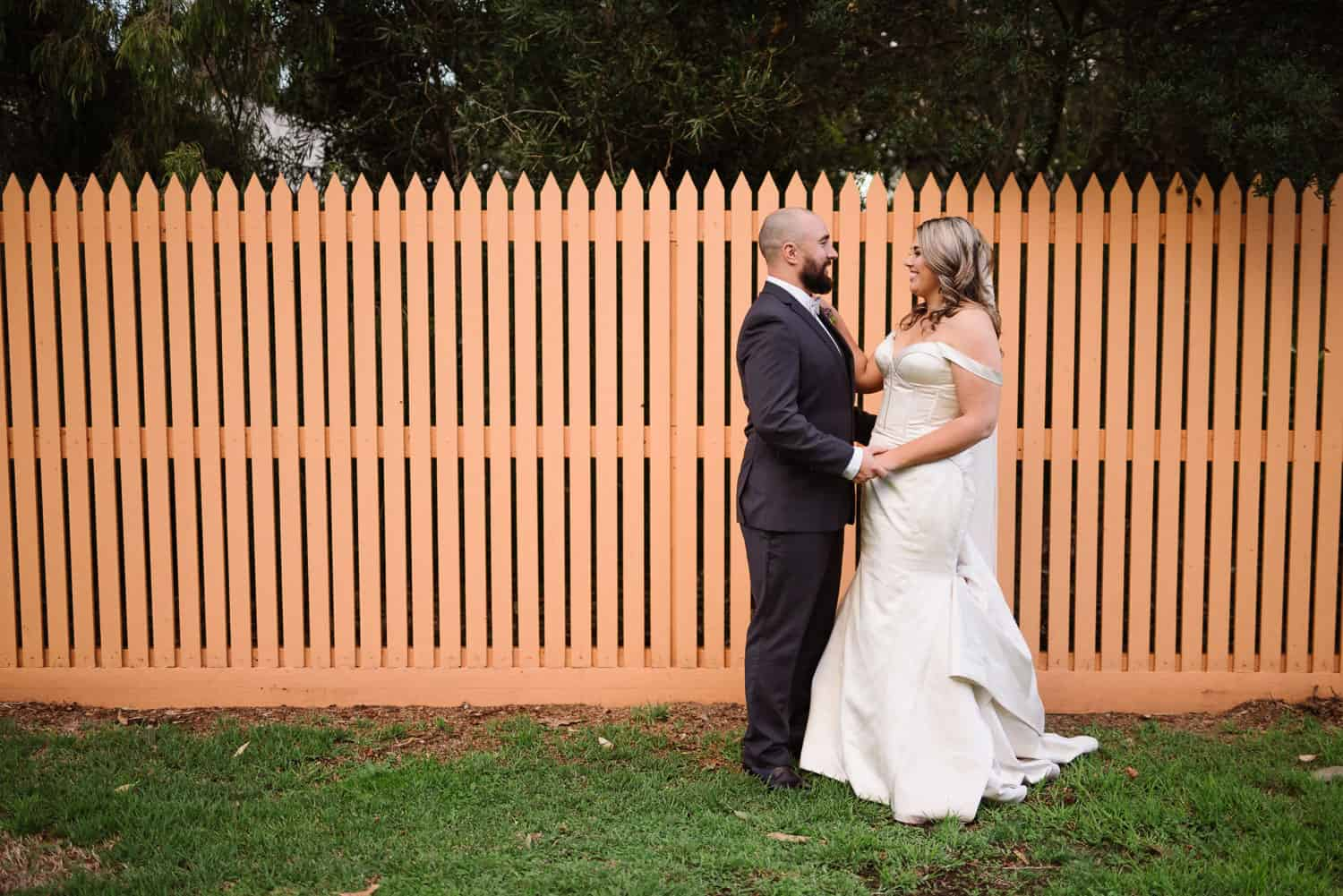 Wedding portrait with an orange fence
