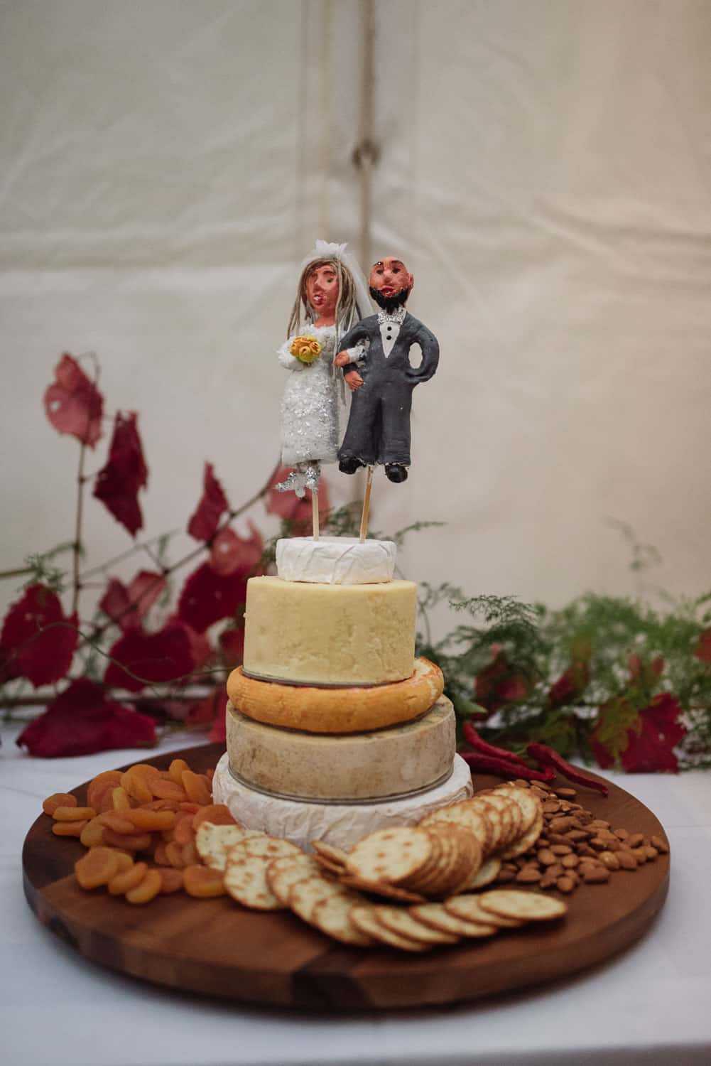 Cheese wheel cake with custom toppers
