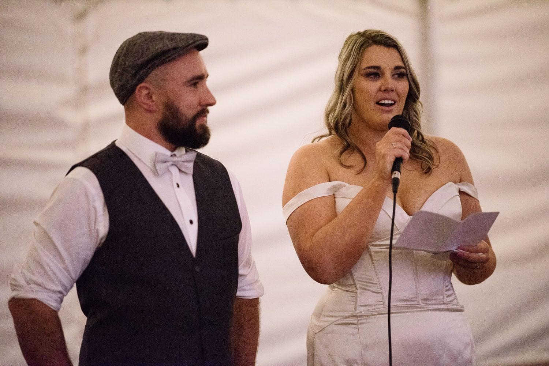 Bride giving a speech post wedding