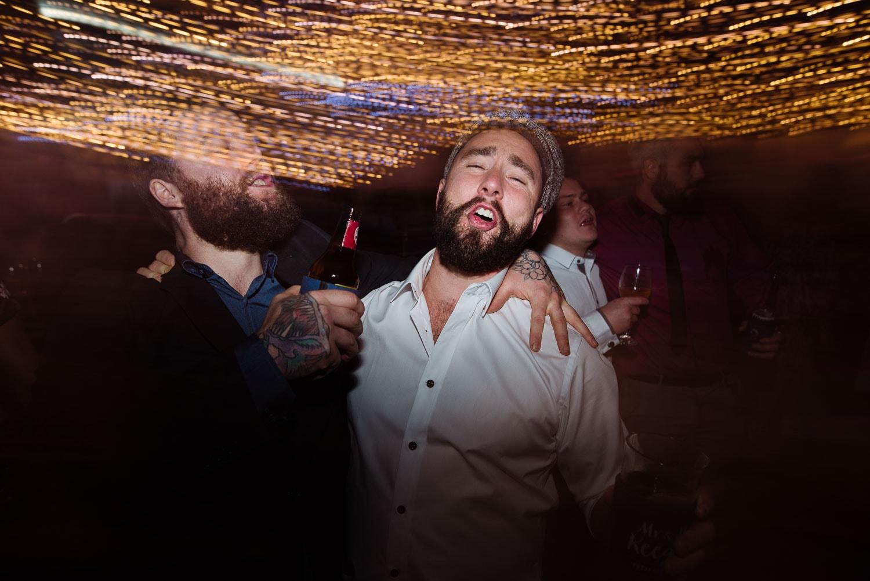Groom having fun on the dancefloor at his wedding