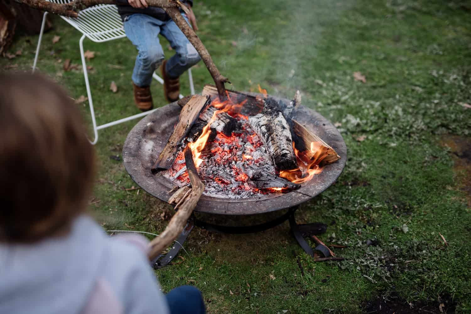 children playing around an open fire