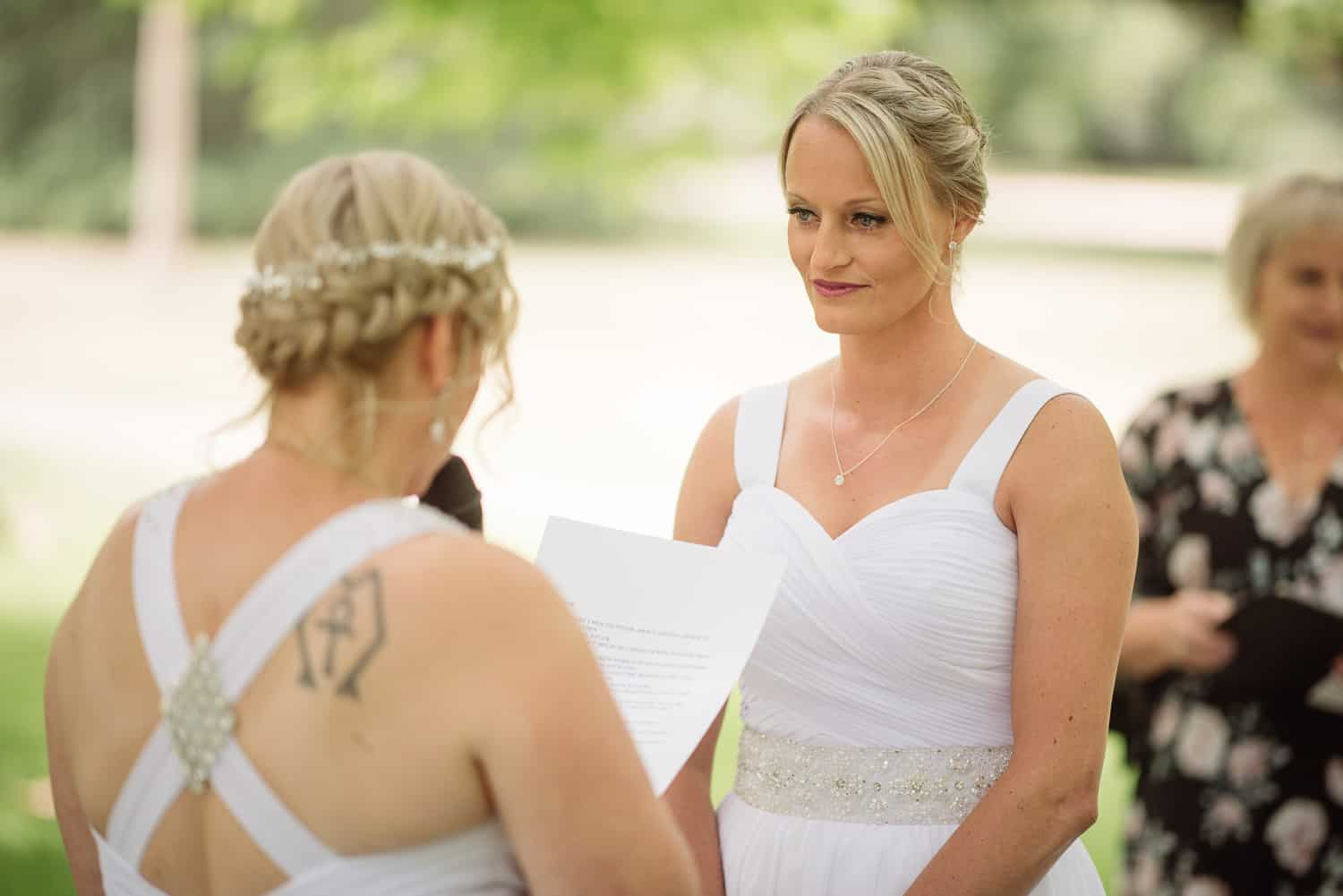 Brides exchange vows at a colac botanic garden wedding