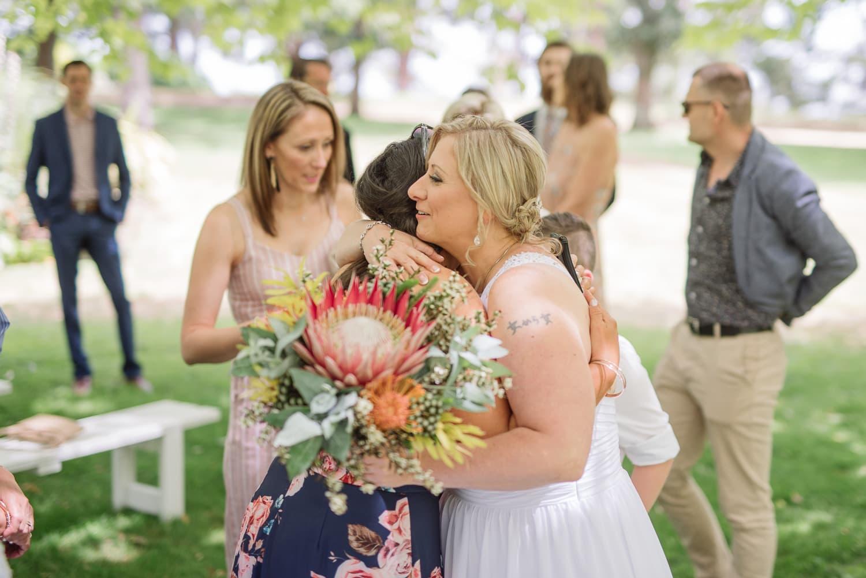 bride hugs guests at a colac wedding