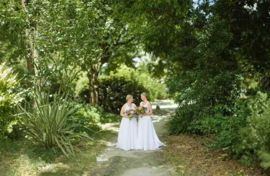 Brides in Colac botanic gardens after a same sex wedding