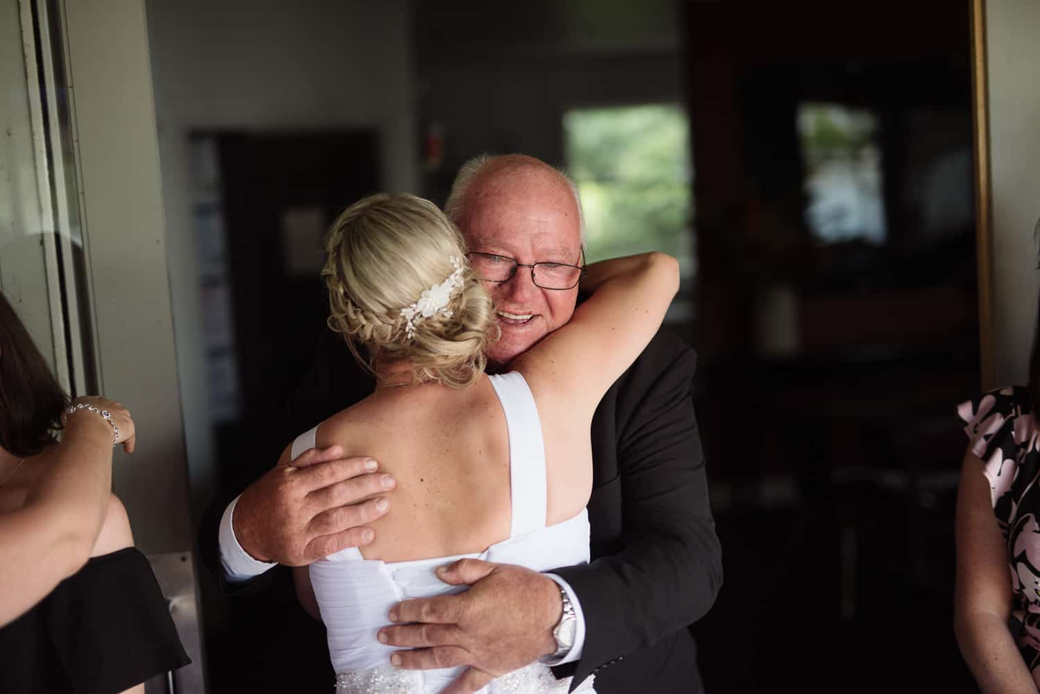 Bride hugging at Colac Cafe on the Lake