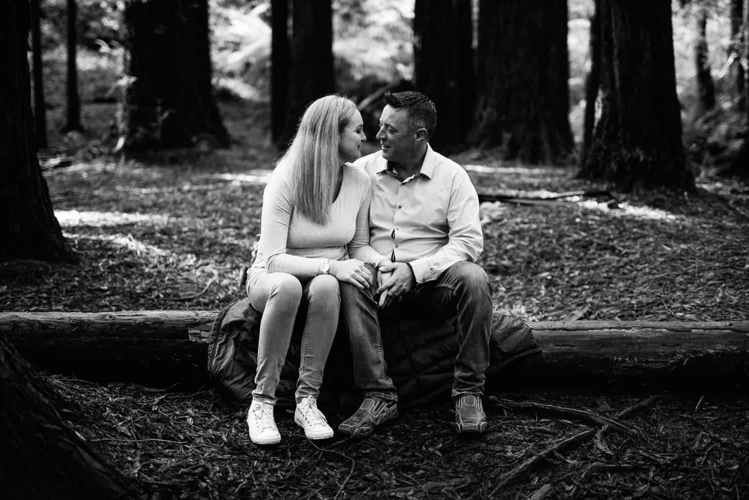 Couple sitting in the Redwoods