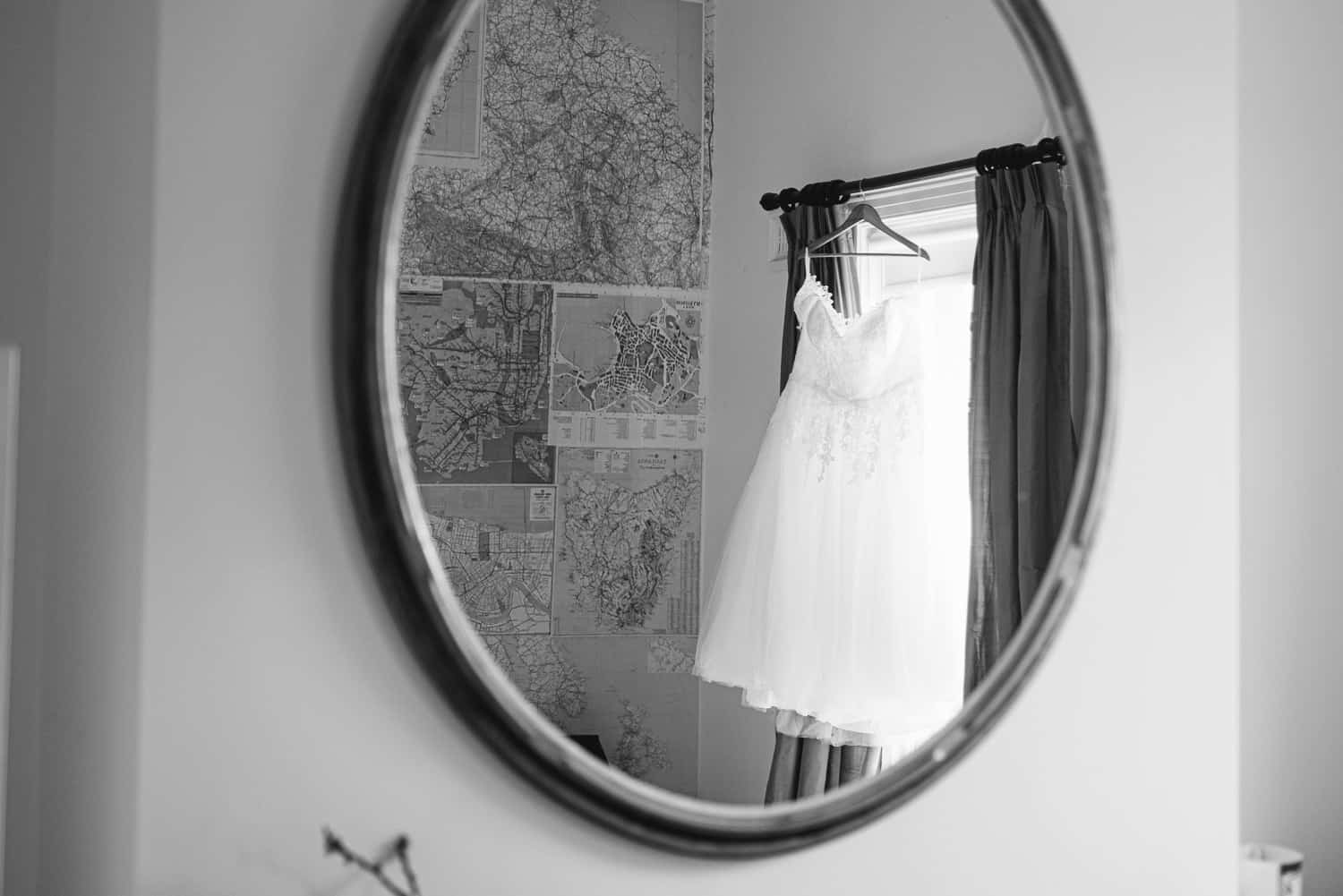 Wedding dress reflected in a mirror at Blauvelt Park