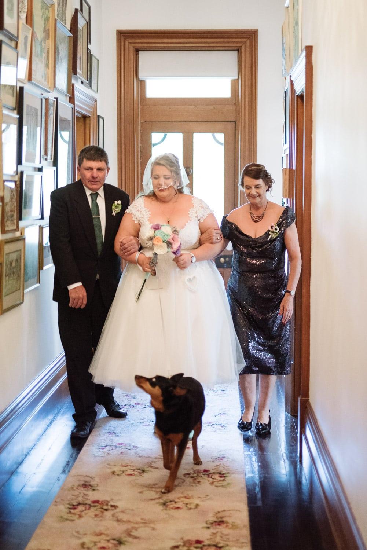 Bride walks down aisle at Baluvelt Park