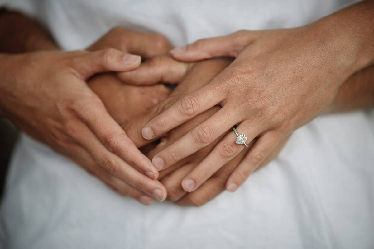 Engaged couple's hands