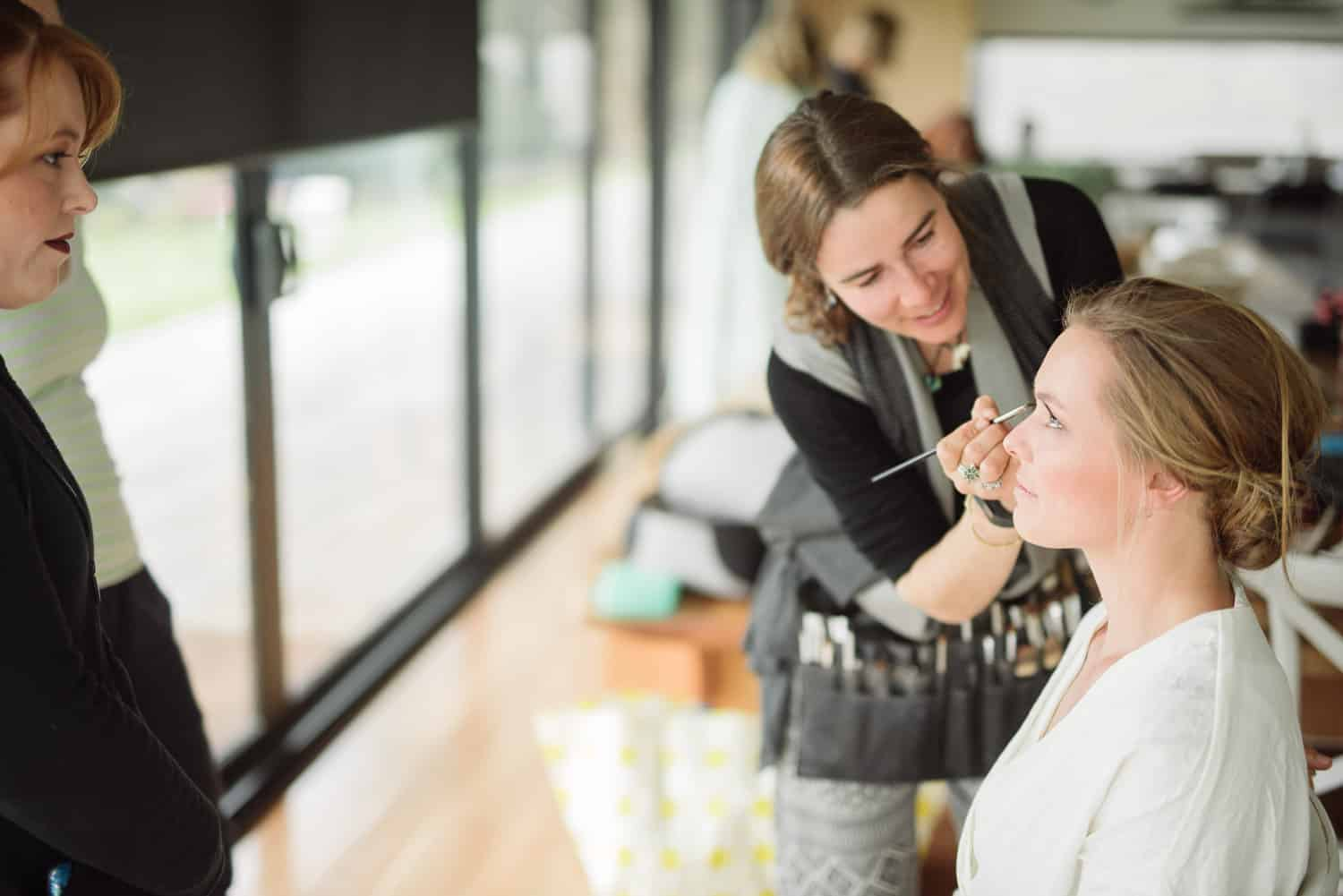 Bride getting makeup done at The Elliot wedding venue