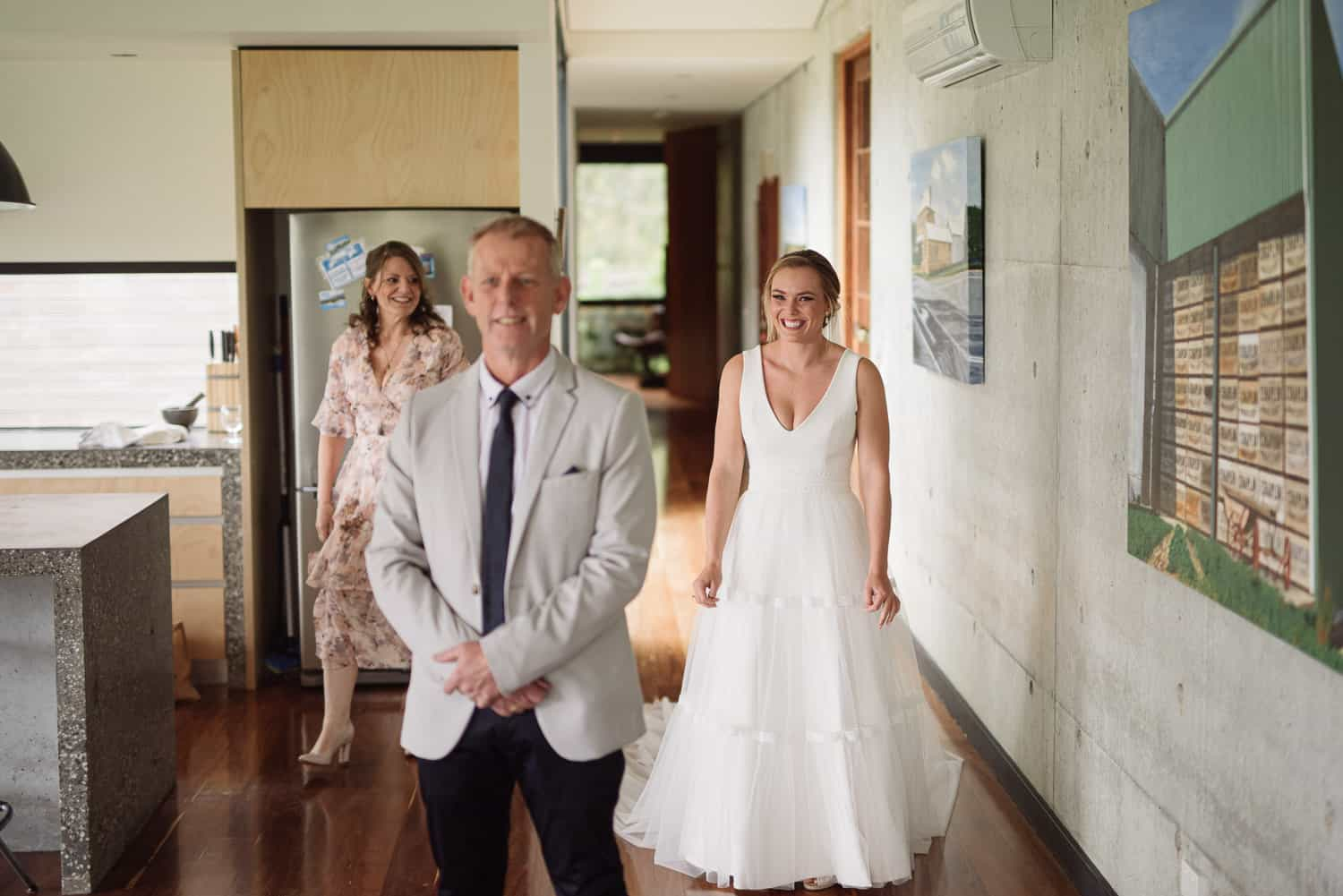 Bride and mother surprise father before her wedding