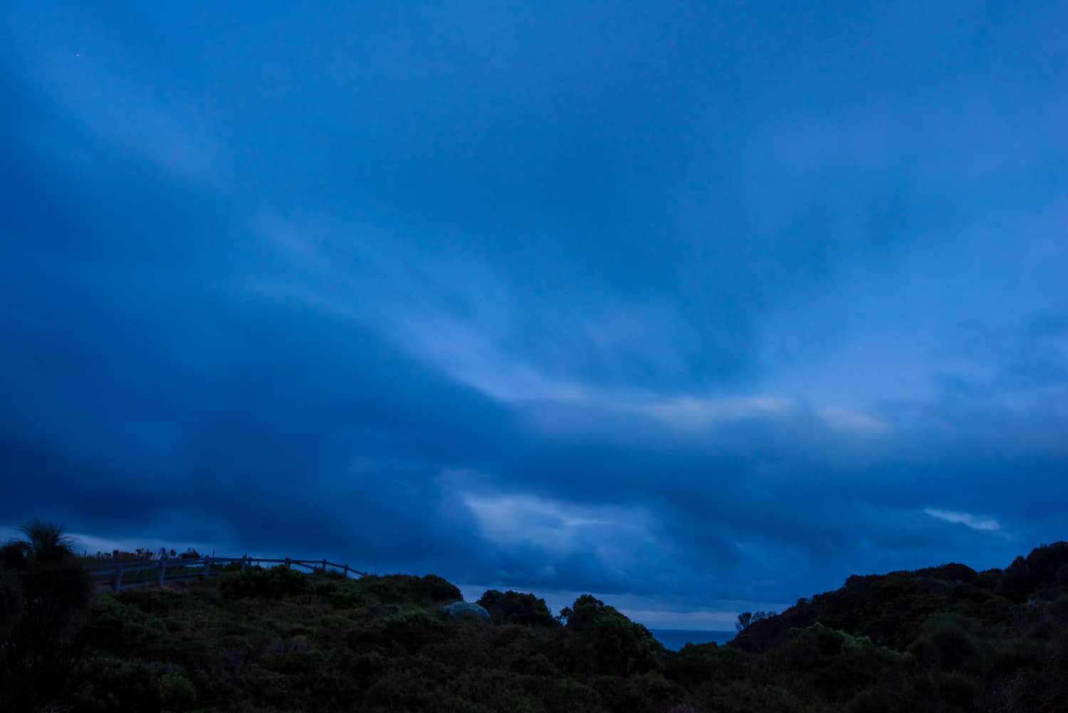 Blue sky at dawn over Castle Cove
