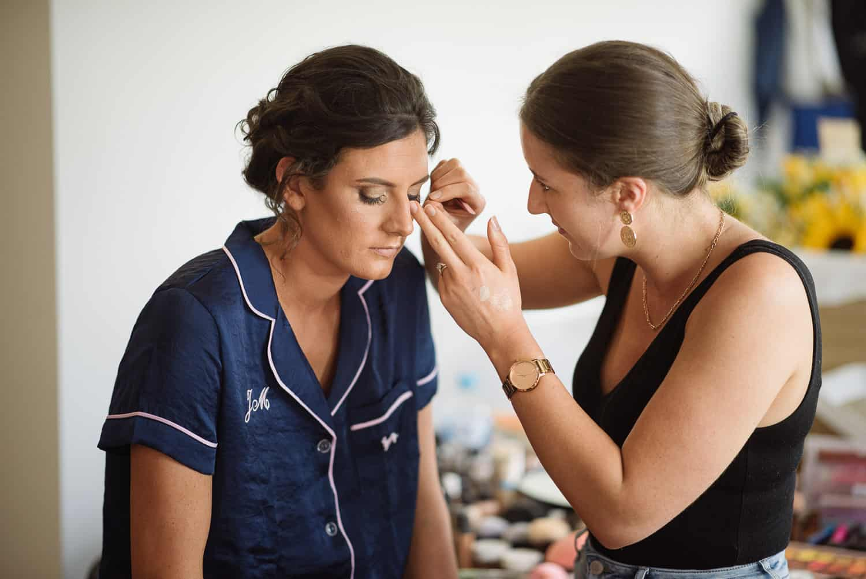 Bride getting makeup done in Cobden